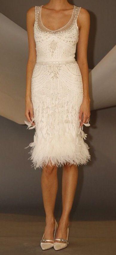 Sleeveless white dress with white beading detail and feathers!!!  Soooooo pretty! ~ Carolina Herrera #shortweddingdresses