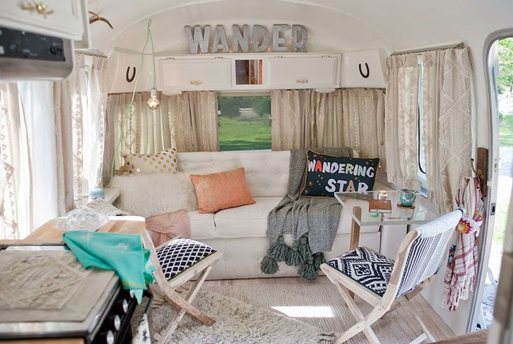 "Sarah's Airstream was dark when she purchased it, but she quickly painted everything white, and installed hardwood floors. ""I salvaged the original sofa and recovered it in bleachable indoor and outdoor linen,"" she writes. ""The wandering star pillow was my inspiration for the interior. I fell in love with the phrase, and the colors, and the term 'wander' began to appear throughout the design."" RELATED: 14 Gorgeous Camper Decorating Ideas"