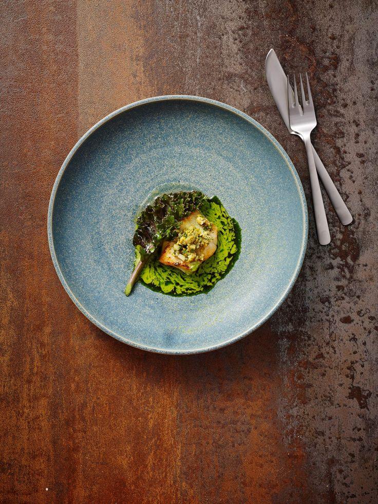 Morten Falk. Kay Bojesen Grand Prix fish fork and fish knife. Photo: Henrik Freek Kvist Christensen. Kay Bojesen Grand Prix cutlery. Danish Design.
