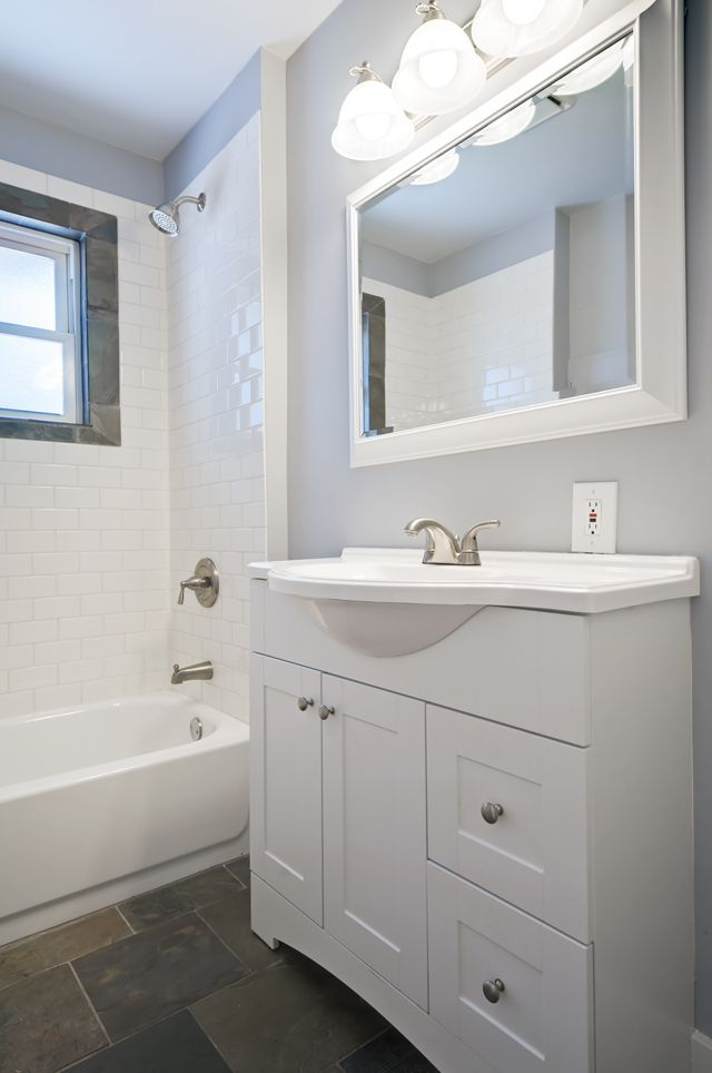 small sink vanity for small bathrooms%0A white subway tile  slate tile in bathroom  gray walls  white vanity