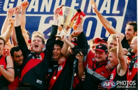 Essendon celebrates after winning the 2000 AFL Grand Final between the Essendon Bombers and the Melbourne Demons at the Melbourne Cricket Ground.