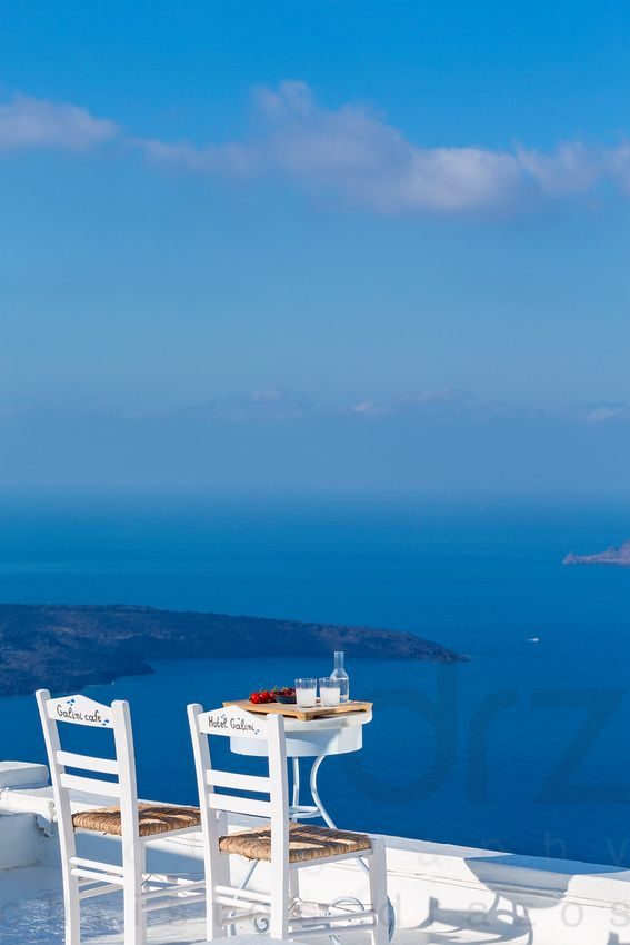 "Enjoying a drink and the stunning view at ""Galini Cafe"" in Santorini (photo by Christos Drazos)"
