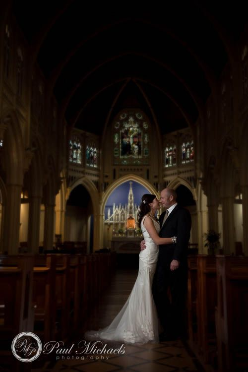 Romantic couple at St Mary's church, Wellington.  #Wedding #photographers, #Wellington, New Zealand. http://www.paulmichaels.co.nz/