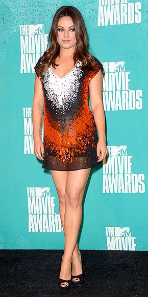 short orange-and-white sequinned Fendi dress and black peep-toe Jimmy Choo heels