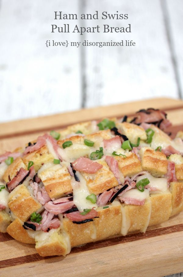 This pull apart bread is made with cheesy, gooey swiss, Virginia ham, and takes less than 30 minutes to make. Perfect for noshing in a hurry!