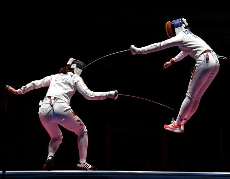 Ana Maria Popescu of Romania competes against Anqi Xu of China during the Women's Epee Team Gold Medal Match bout on Day 6 of the 2016 Rio Olympics [Getty Images]
