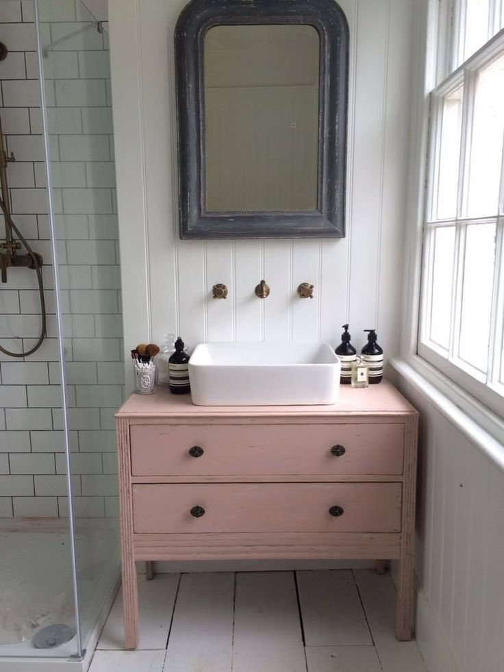 Pink wall unit in bathroom
