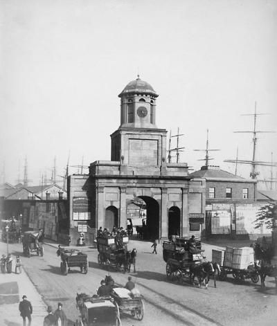 The original entrance to the East India Docks, c1890. The security of the area was provided by means of tall walls and a private police force. All port police forces in the UK to this day are still private