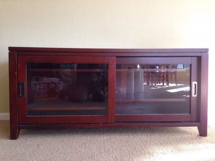 Contemporary Laminate Mahogany TV Stand with Two Storage Drawers, bearing glass front sliding doors