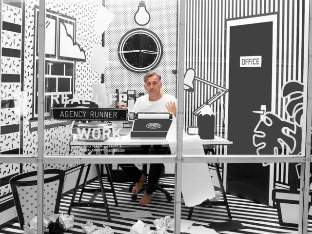 All this month, advertising agency Wieden + Kennedy has been giving passers-by a surprise with its window installation Real Life at Work. At the agency's London office in Hanbury Street, illustrator Emily Forgot and 3D artist Laurie D turned a street-facing window into a monochrome scene of office life, recreating furniture and objects in paper and card. Throughout August W+K employees have been taking turns to work from the window, with their actions being recorded for the live stream…