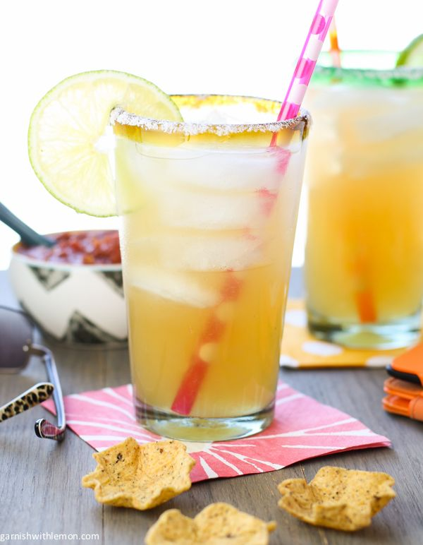 Golden Margarita- 3 oz gold tequila, 3 oz Grand Marnier, 3 oz fresh lime juice, 3 oz simple syru,p Lime wedge for garnish