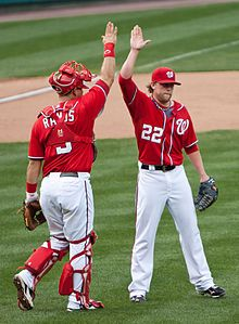 """High five -The gesture takes its name from the """"five"""" fingers & the raising of the hand """"high"""". The gesture probably originated in American professional sports. Drew Storen (right) & Wilson Ramos of the Washington Nationals 2011."""