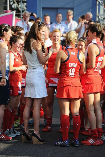 Catherine, Duchess of Cambridge talks to Team GB after their Women's Hockey bronze medal match against New Zealand on Day 14 of the London 2012 Olympic Games at Riverbank Arena Hockey Centre on August 10, 2012 in London, England.