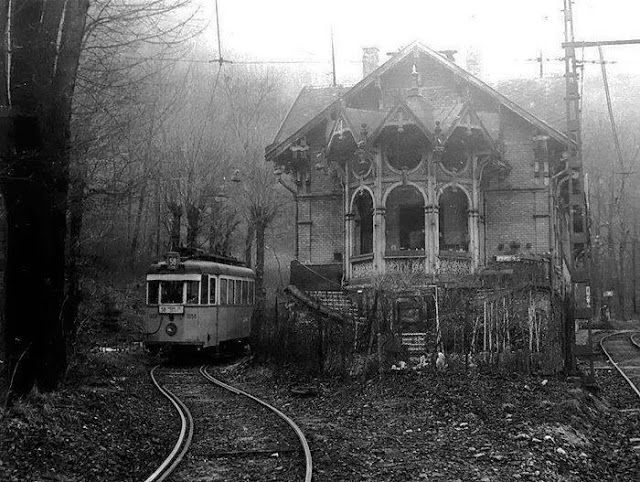 Abandoned European Railway: An old multiple unit train sits in a lonely siding next to a ramshackle signal box.