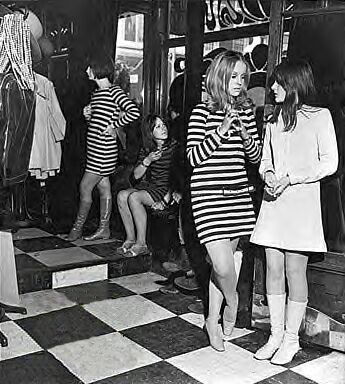 "Mod Fashion: group of young people in Britiain in mid 1960's; mod fashion statement was elegance, long hair, granny glasses, and Edwardian finery. Males as well as females were entitled to wear handsome and dashing clothing. Wide range of clothing associated with mods included: miniskirts, maxi full length ""granny dresses,"" knee high socks and boots, shift dresses, etc."