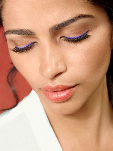 Draw a thin line of bright eyeliner close to your lids and then load up on mascara.