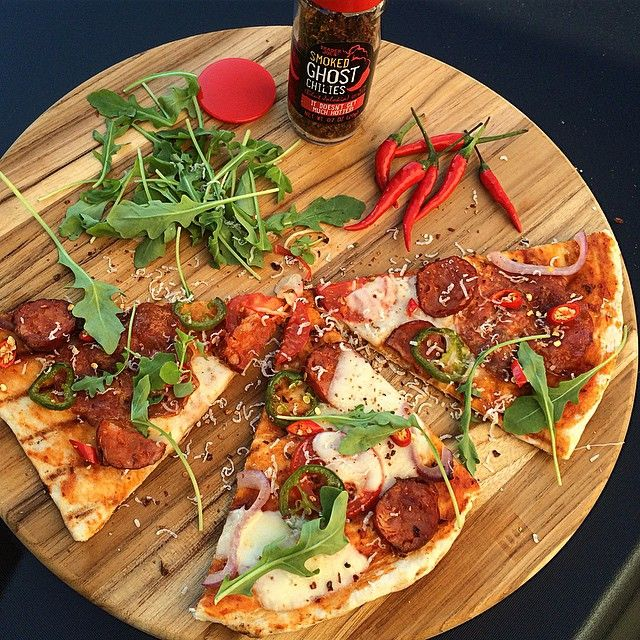 Cooking for a party is a lot of fun, but doesn't allow us to crank up the heat the way we like it. Tonight's fix is spicy bbq pizza with extra hot chorizo, hot salami, jalapeños, Thai chilies and smoked ghost chilies to top it off. @zimmysnook