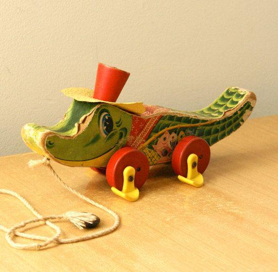 Vintage Fisher-Price alligator pull toy.