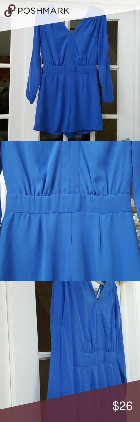 Royal Blue Romper! This is a gorgeous dressy royal blue lined poly romper!  This beauty has sheer sleeves with open slits, and elastic at the wrists, and is in excellent condition! Charming Charlie Shorts