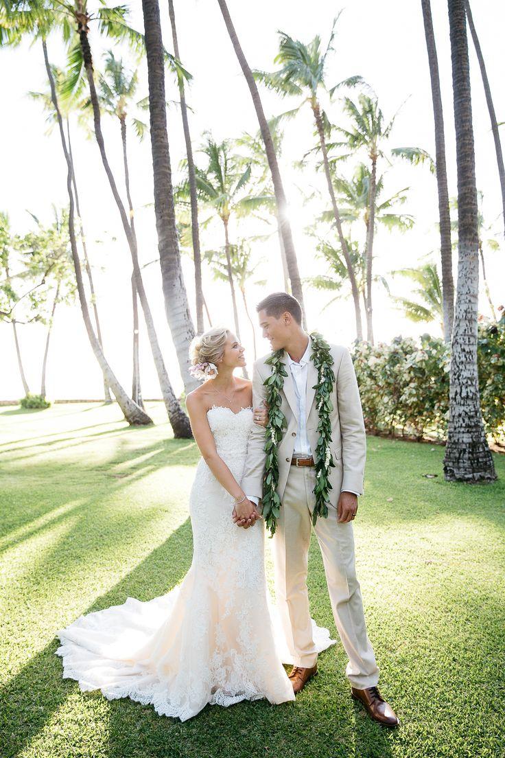 Tropical wedding attire, strapless lace wedding dress, tan groom suit, maile lei, Hawaii // Makai Creative