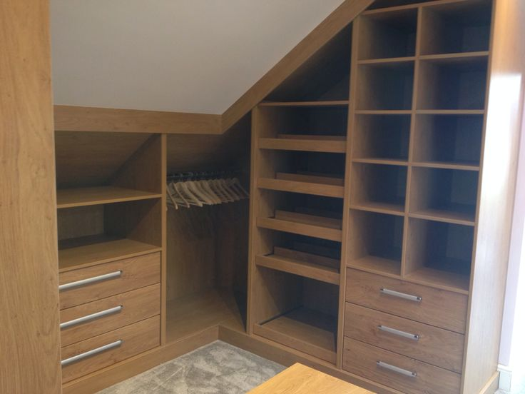 in wardrobe fitted into the eaves for more pictures of this bedroom