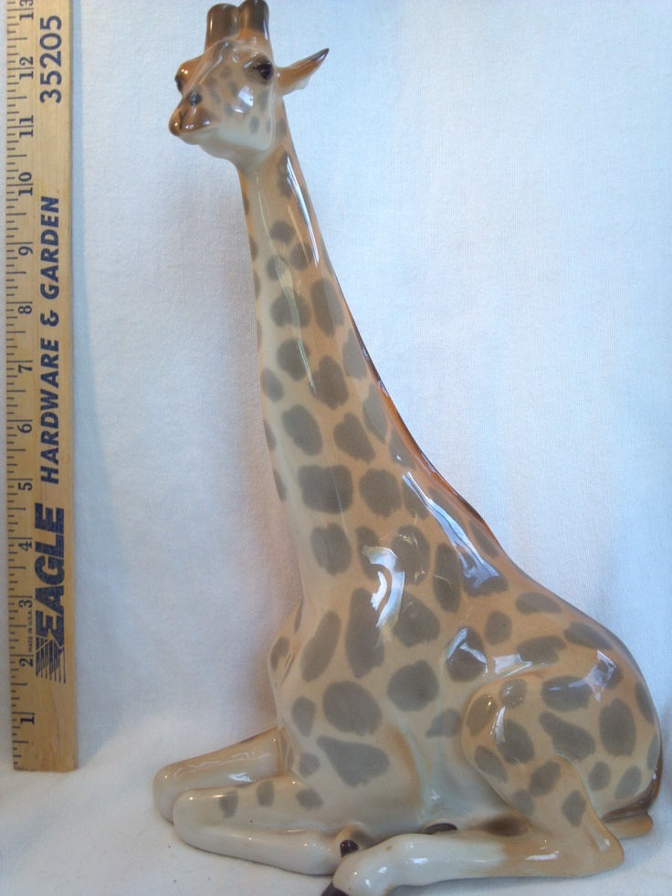 Lomonosov Porcelain Long Neck Giraffe figurine measures 11 1/2 inches tall, 8 inches long. The size in cm is 30 cm tall x 20cm long.