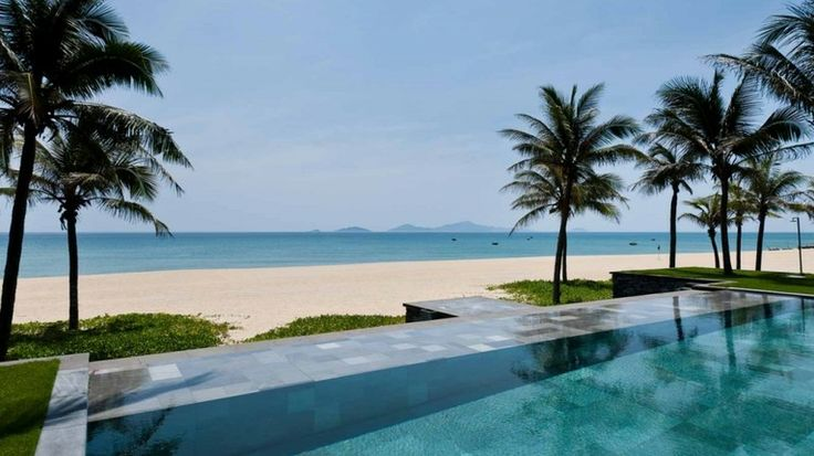 The stunning beach front and infinity pools at the Nam Hai Hotel, Hoi An, Vietnam.