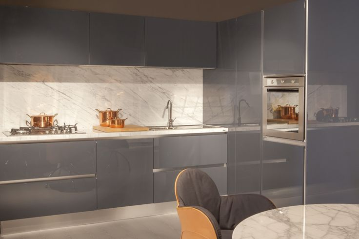 "Don't miss out on 40% off this Ernesto Meda kitchen ""Cucina One"". Original price: €13.700,00. Our price: €8.300,00 (iva included) Transport and installation not included. Description: cabinets with ""Easy"" lacquer finish in marine grey; ""Road"" steel handles, worktop and backboard in white Carrara #marble; stove, oven, dishwasher and fridge all Whirlpool; hood vasistas SKLOK Electrolux Rex; sink and draining board Foster. #cucine #kitchen #kitchensale #designsale #design #home #kitchendesign"
