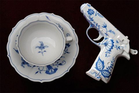 """By artist Yavon Schultz """"The fragile weapon, hand-painted in the style of classic tableware motifs, liesnext to your coffee and cake, asking to be picked up. Its coolness andcomfortable grip increase the qualms of the user, leaving him in a quandary between the pleasure of luxury and violence."""""""