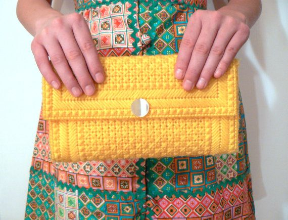 Vintage sunny yellow plastic canvas clutch. $10.00, via Etsy.