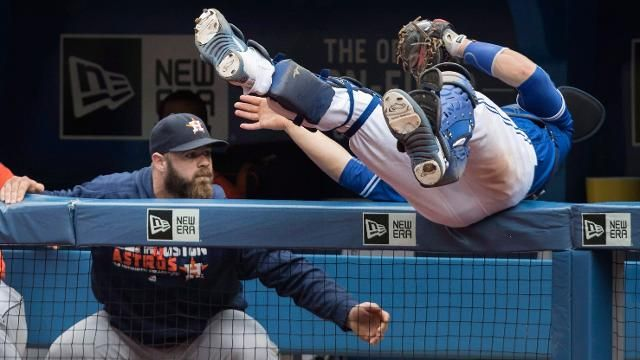 Toronto Blue Jays catcher Russell Martin leans, rolls and makes a beautiful catch over the Houston Astros dugout.   Click on this pin to see the video Aug 14, 2016