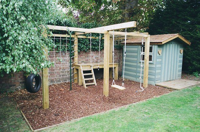 Children's playframe with swing, monkey bars, climbing net and play bark