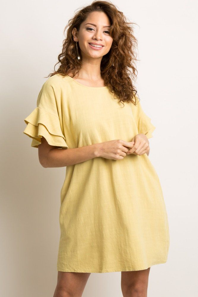 d64f9c5ef455a A lightweight linen shift dress featuring short sleeves with a layered  ruffle trim and side pockets. Additional details include a rounded neckline  and a ...