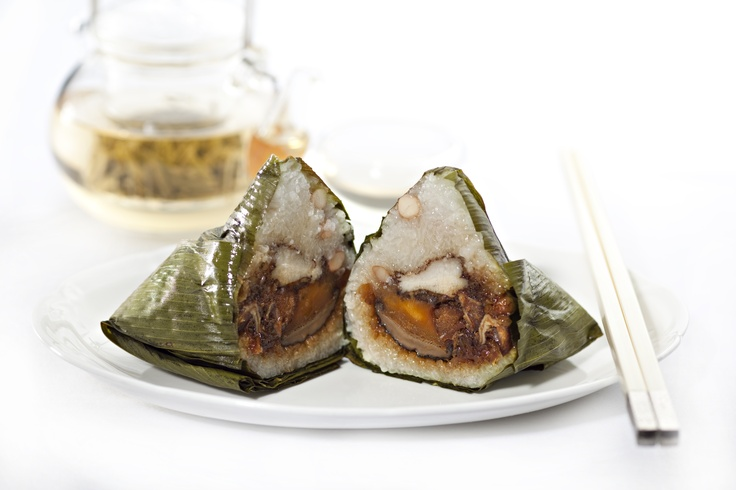 Xin Cuisine's Home-made Traditional Dumpling  Generously filled with five-spiced braised pork bellly, mushroom, shrimp and salted egg yolk. Home-made goodness and great flavours bursting with every bite! — at Holiday Inn Atrium Singapore