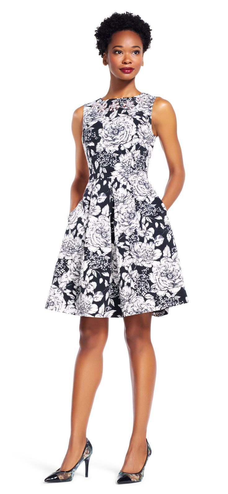 This fit and flare dress is not your garden-variety floral print. This short dress features all over hand-drawn floral print, large pleats to create a full skirt, v-back and convenient pockets. Featuring a sleeveless silhouette and a jeweled neckline, this pretty party dress doesn't need over-accessorizing. Add your favorite pumps and this look is complete.