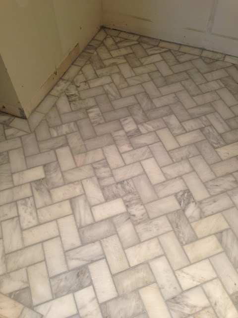herringbone bathroom floor tile herringbone tile floors grey grout foyer for the casa 18701