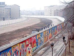 The Berlin Wall taken from the West side. The Wall was built in 1961 to prevent East Germans from fleeing and to stop an economically disastrous drain of workers. It was a symbol of the Cold War and its fall in 1989 marked the approaching end of the war.