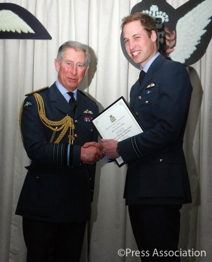 The Prince of Wales presents Prince William with his wings at a graduation ceremony at RAF Shawbury in Shropshire where Prince William completed an advanced helicopter training course.