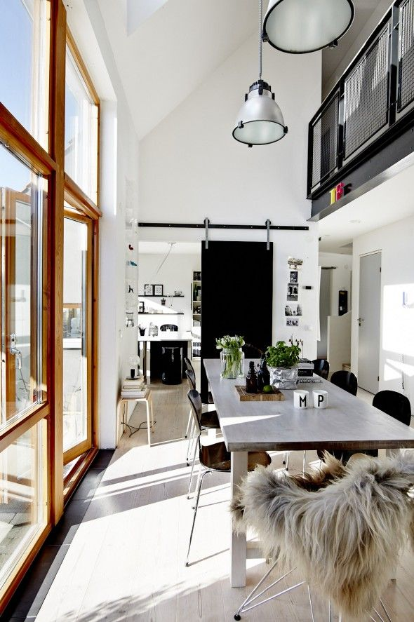 Dining Room And Kitchen With A Barn Door COCO LAPINE
