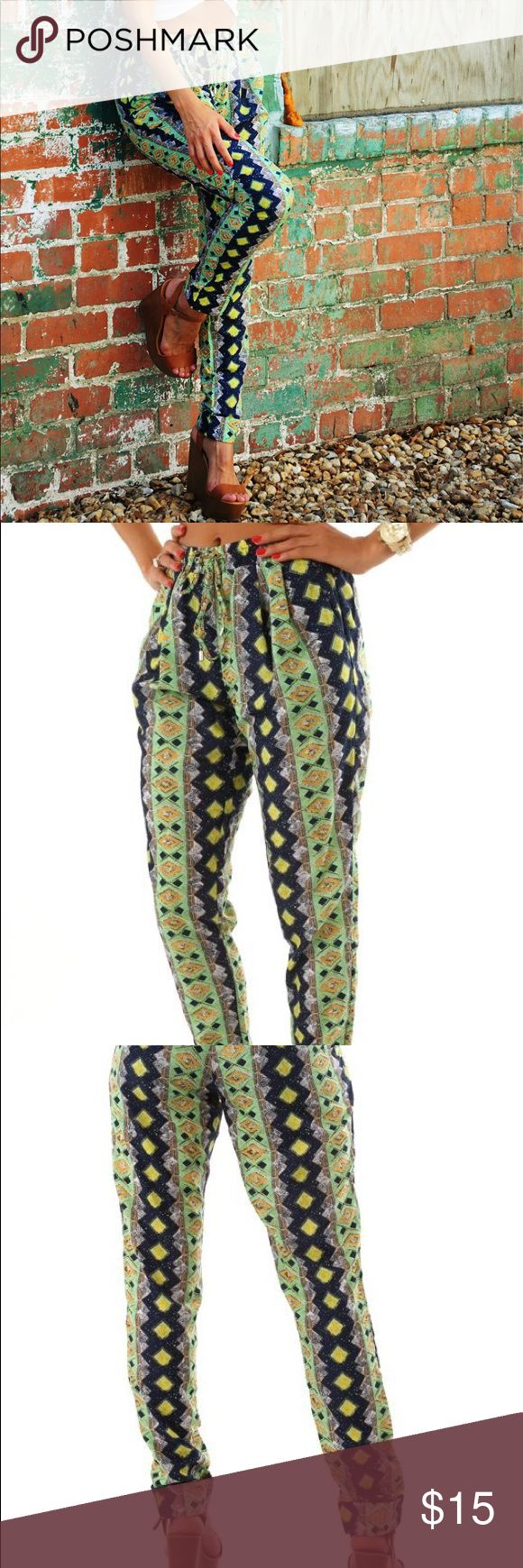 Multi Color Aztec Print Joggers Never Worn. Aztec Print higher style pants. Fully lined. High waisted. Elastic waist with tie. Tapered pant. Very J Pants Trousers