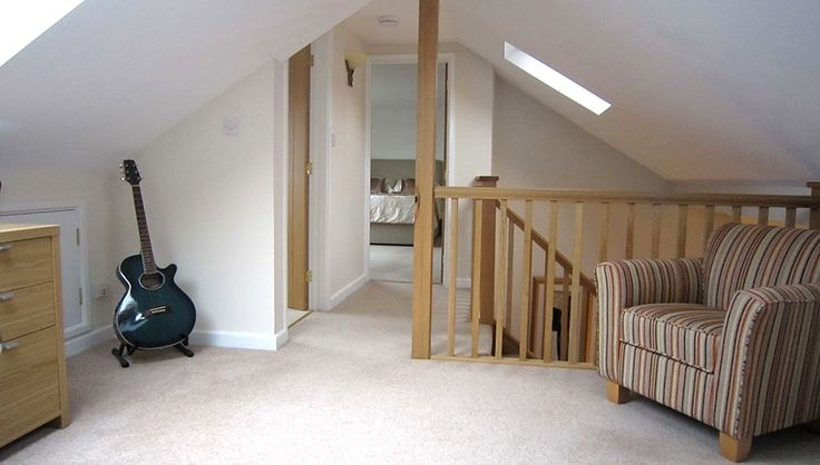 Open plan study with bedroom and bathroom in a dormer bungalow loft conversion.