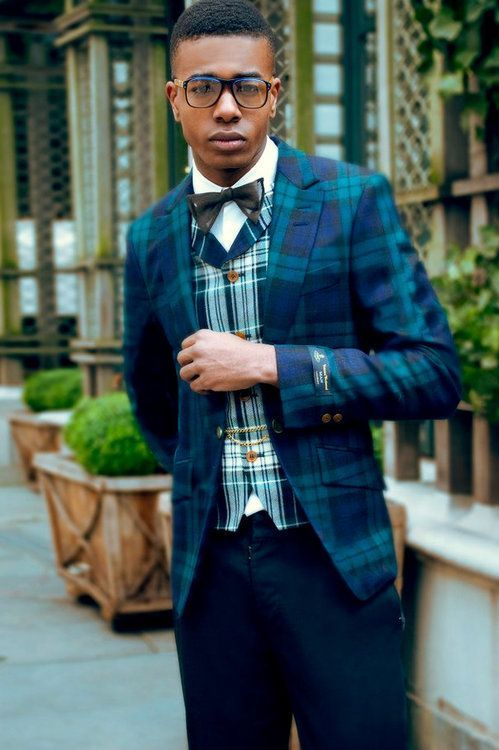 Something as simple as teaming an aquamarine plaid blazer with navy chinos can potentially set you apart from the crowd.  Shop this look for $406:  http://lookastic.com/men/looks/blazer-and-vest-and-chinos-and-bow-tie-and-dress-shirt/757  — Aquamarine Plaid Blazer  — Green Plaid Waistcoat  — Navy Chinos  — Black Bow-tie  — White Dress Shirt
