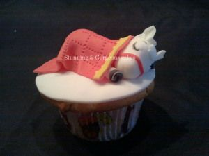 I dont know why there is an adorable donkey sleeping on this cupcake, but i love it