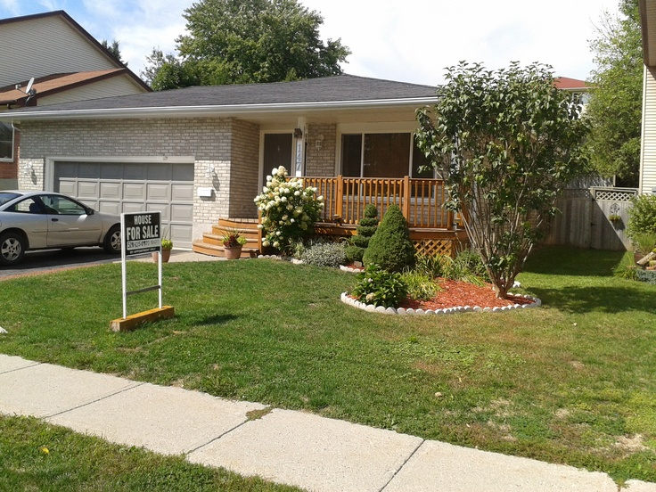 Curb appeal with curved gardens,mini spruce trees, perennials ,and a large front porch to sit out on those nice evenings  For more info realtor.ca MLS# X2487442