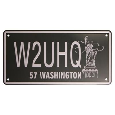 USA Washington nummerplade. Amerikansk nummerplade fra staten Washington. USA vægskiltet er præget og har teksten Washington og et billede af den ikoniske Amerikanske frihedsgudinde.