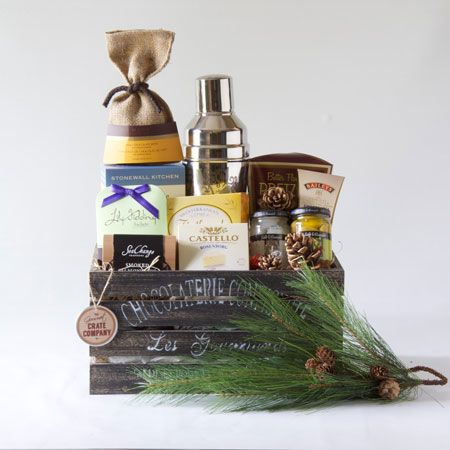 Shaken, Not Stirred. Look out for this perfect referral gift or client thank you gift.  Sleek cocktail shaker, along with tipsy items and gourmet snacks make this crate a winner!