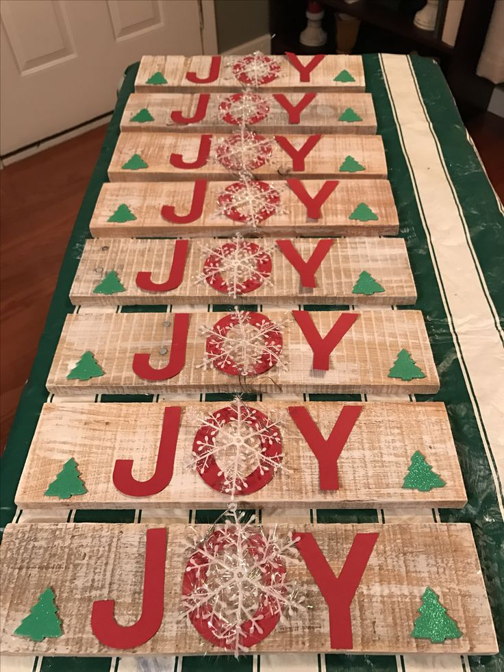 JOY sign using pallet wood and snowflake embellishments