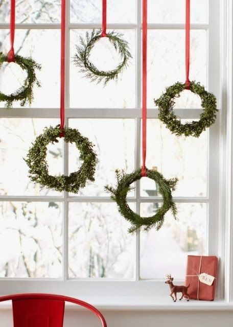 FOCAL POINT STYLING: CHRISTMAS KITCHEN DECORATING IDEAS mini wreaths from boxwoods, herbs, hung from red ribbon in window