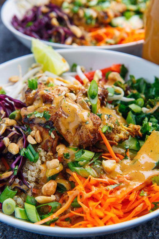 Thai Peanut Chicken Buddha Bowls / 356 cal, 21g F, 23g C, 21g P / quinoa, kale, bean sprouts, carrot, cucumber, red bell pepper, cabbage, chicken satay, peanut dressing, peanuts, green onions, cilantro