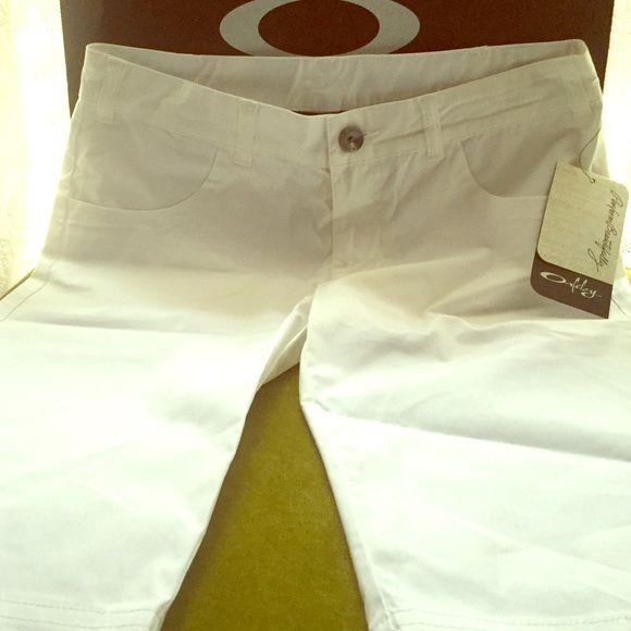 """Oakley  Walking Shorts, NWT Oakley, Walk Short, NWT.  Super cute, bright white, front pockets, one flat back pocket, pink Oakley Logo in the back, longer length, 12"""" inseam. Oakley Shorts"""